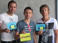 "What is Muse's secret to ""Survival""?  A healthy dose of NPR lovin', of course!    (l to r) Chris Wolstenholme, Matthew Bellamy and Dominic Howard 8/17/2012"