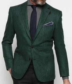 evergreen herringbone blazer, windowpane check, navy silk tie, tipped pocket square