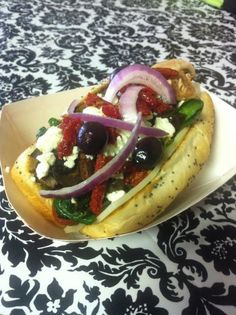 This Greek Dog is a Vienna beef dog on a poppy seed bun with fresh spinach, sun dried tomatoes, feta cheese, kalamata olives, grilled portabellas and red onions!