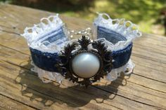 This bracelet was made from the side seam of a pair of jeans. It has loop lace trim and a pretty center piece.