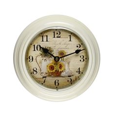 Furnistar White Iron Vintage-Inspired Round Wall Clock. This beautiful antique-inspired wall clock features black easy to read numbers on a pale gold background with a detail of a watering can and sunflowers. This clock looks lovely on a kitchen living room or bedroom wall and makes a wonderful housewarming wedding or anniversary gift