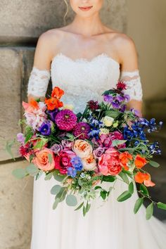 Colorful themes will start edging out neutral, blush themes, and we love the vibrancy of this trend! Choose a palette of bright blues + violets or warm tones like oranges + corals for a modern look. Or go full rainbow 🌈 for a fun, bold statement like thi Wedding Flower Guide, Beach Wedding Flowers, Wedding Flower Arrangements, Flower Bouquet Wedding, Floral Wedding, Wedding Day, Bridal Bouquets, Colourful Wedding Flowers, Bright Color Wedding