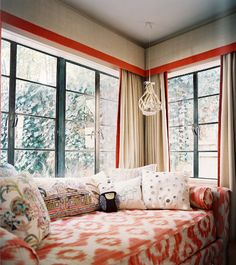This is where I want to live. Red patteren, curtains, pillows.