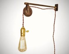 Antique Lighting With Pulley Light Fixture Design Idea With Polished Brass Color Fixture Also Classic Hangings Bulb And Minimalist Sturdy Wall Mount Bracket And Rope Cable. Antique Lighting, Industrial Lighting, Cool Lighting, Lighting Ideas, Lamp Cord, Lamp Socket, Brass Lamp, Pendant Lamp, Bronze Pendant