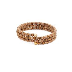 This stylish Marisa Bronze Wrap bracelet is the ultimate bohemian glam. Stations of golden beads wrap around your wrist multiple times. Casual yet oh-so hip, you'll love to update your everyday look with this layering bracelet. Find it on Splendor Designs