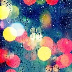 Window with rain and lights. Wallpaper