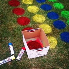 Use a DIY stencil to spray rows of circles with yard paint — no mat needed here!