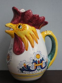 """THE LEGEND OF THE ITALIAN ROOSTER PITCHER Good Fortune Awaits You at coloridellaceramica.com The Italian Rooster Pitcher symbolizes """"Good Fortune"""" and/or """"Good Luck"""". It is believed to protect one from dangers. It is an Italian tradition to give a ceramic Italian rooster pitcher to a friend or loved one as a housewarming or wedding gift or buy one for yourself and bring """"Good Fortune"""" and/or """"Good Luck"""" to your home. Rooster Kitchen, Kitchen Ware, Italian Wedding Traditions, Ceramic Rooster, Vintage Dishware, Italian Tiles, Italian Home, Good Luck To You, My Heritage"""