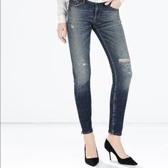 Zara Japanese Denim Mid Rise Jean Very beautiful boyfriend fit jeans, with the right amount of distress! I hemmed the jeans myself, I'm 5'2 and like to roll up the jeans to show my ankles. The tag is starting to come off, but the jeans are barely used - probably worn no more than 3 times. Inseam is 26', length is 34' Zara Jeans Skinny