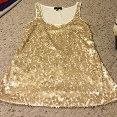 Express sequin tank XXS Fits like an XS. cream base and gold sequins individually seen on. Worn twice. EUC. smoke free/pet free home. Express Tops Tank Tops