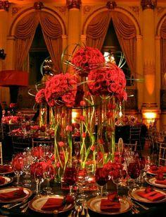 Dramatic red, gold, and black ballroom decor via Bridal Expo Chicago