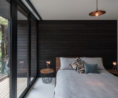The guest bedroom opens onto the rear deck of the home. Photograph by Jeremy Toth.