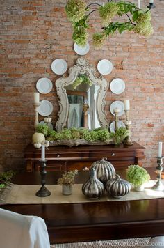 Absolutely love this mirror!  Of course, what's not to love?  Plates on the wall, brick wall, beautiful antiques, hydrangeas...ahh