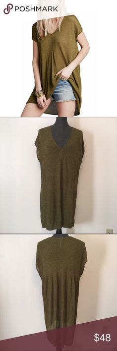 """Free People Army Green Tunic d e s c r i p t i o n  Free People breezy tunic featuring a lightweight, gauzy fabrication. V-neckline and shapeless silhouette make for an easy, effortless fit. Raw edges make for a lived-in look. Small hole (as pictured) but unnoticeable when worn.  c o n t e n t  57% viscose 