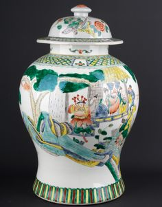 Description A large bulbous Chinese porcelain vase & cover, brightly decorated in famille verte enamels around the body with several groups of Immortals & deities on a verandah, on a boat & in the air, between formal reserved diaper & lappet bands.  Date Second half 19th century  www.collectorstrade.de