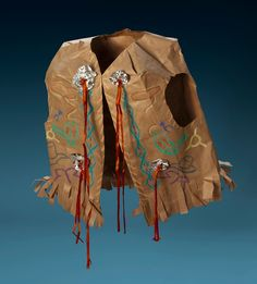 Native American Vest craft made with brown paper grocery bag, tin foil, and ribbon