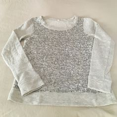 Jcrew gray sequin sweatshirt Jcrew gray sequin sweatshirt. 100% cotton. Gently worn, great condition. J. Crew Tops Sweatshirts & Hoodies