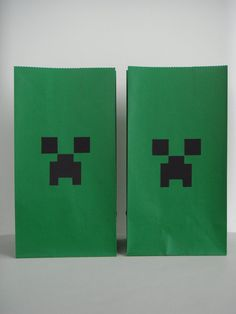 Minecraft birthday party favor treat bags - just black squares of construction paper on green bags. EASY!