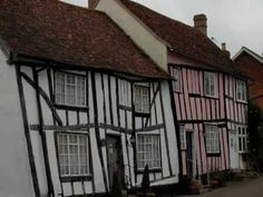 """The Crooked Houses of Lavenham, England.  (It is thought that the town was the inspiration for the poem, """"A Crooked Little Man."""" The town was built using green wood for many of the houses and over the years as the wood aged, the buildings became distorted and out of alignment, hence, many crooked little houses)."""