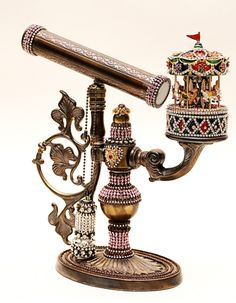 I don't know what this is. It is Russian and so beautiful. I love the tiny carousel.