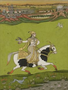 A PORTRAIT OF CHAND BIBI HAWKING, INDIA, DECCAN, 18TH CENTURY Gouache heightened with gold on paper, depicting a female figure on horseback riding through a landsape with a hawk on her gloved right hand, accompanied by a dog, laid down on an album page, borders ruled in red, black and gold, outer margins filled with leafy flowers in gold