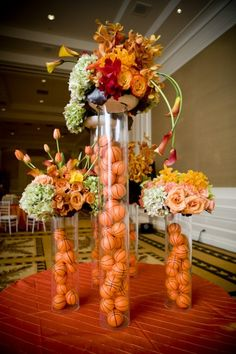 . Use footballs or lacrosse Basketball centerpiece for a graduation party. With white and green ping pong balls?