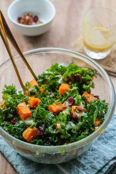 Spicy roasted sweet potato & kale salad with a maple tahini dressing topped with pecans and dried cranberries | grain free + vegetarian