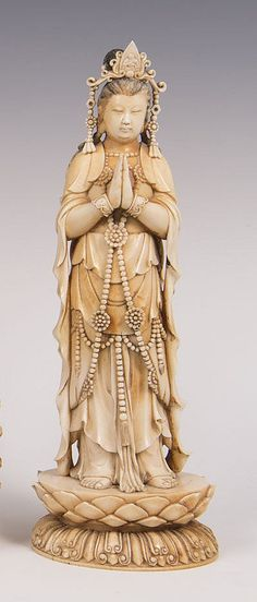 Fine quality late nineteenth century Japanese carved and stained ivory okimono of a Goddess standing on a lotus flower, 30cm high
