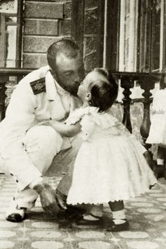 Grand Duke Alexander Mikhailovich kissing his son Prince Andrei.