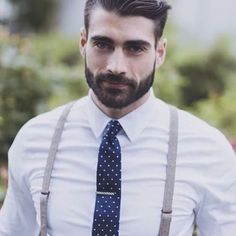 Really digging the suspenders and tie look in this shot from @mensfashions. Photo by @alixann loosle photography courtesy of @GroomsFashion #formalwear #shirtandtie #suspenders #mensfashion #menswear #lifestyle #beards #beardbrand #beard