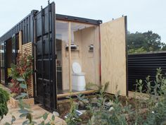 Perennial Paradise shipping container side view bathroom, pond
