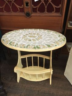 I would like to do this to my TV tray tables....How to Add a Mosaic Makeover to an Old Table (Using Plates!)