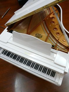 I recently bought this piano for my living room, I love it! http://pinterest.com/cameronpiano