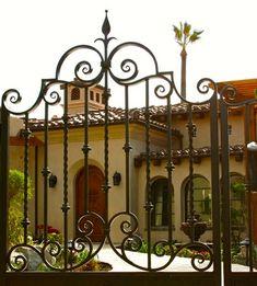 scrolling iron gate , luxury Mediterranean home