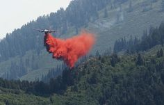 (Leah Hogsten  |  The Salt Lake Tribune)  Tankers filled with fire retardant dropped on the north end of the fire. Firefighters lifted some evacuation orders and called in two hot-shot crews to help battle a still-uncontrolled Utah County wildfire Wednesday. 350 homes remained under mandatory evacuation orders as firefighters fought the nearly 2,900-acre blaze, aided by winds blowing the blaze back up the ridge, away from houses.