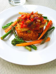 "Jollof Rice. Appetizing Guest Post: Cookbook author, Funke Koleosho of ""Contemporary Nigerian Cuisine Cookbook"""