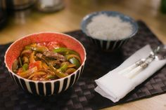 """Canton Beef is a stir-fry that infuses wok-tossed flavors into chunky sirloin beef, roughly chopped tomatoes, peppers, green onions, water chestnuts and onion. As Chef Gok Wan puts it, that's basically """"all the stuff that's left in your fridge after a week's shop."""" What better way to use your leftover fresh ingredients than to turn them into a well-seasoned, slightly charred gravy dish that pairs perfectly with steamed white rice? Gok Wan Recipes, Beef Recipes, What Is Seafood, Easy Asian Recipes, Ethnic Recipes, Vietnamese Summer Rolls, Asian Food Channel, Chicken Katsu Curry"""