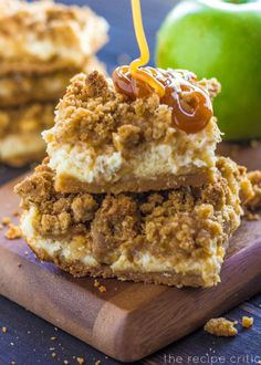 Caramel Apple Cheesecake Bars - There is nothing like biting into a crisp fall apple that has been dipped in caramel.  This delicious caramel apple cheesecake dessert has all of the amazing flavors of fall combined into it.  The best part is the caramel drizzled on top!  Now drool. :)