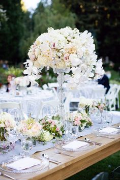 Romantic meets rustic centerpieces. Photography: Janae Shields Photography - janaeshields.com, Floral Design: Nicole Ha Designs - http://nicoleha.com    Read More: http://www.stylemepretty.com/california-weddings/2014/05/07/elegant-outdoor-wedding-at-nestldown/
