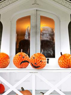 Turn orange tissue-paper balls into proper Halloween pumpkins. Simply cut facial features and stems from construction paper and apply to the balls with glue dots.