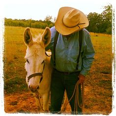 my grandfather and his donkey and i think a cool picture!