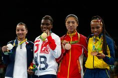 L-R) Silver medalist Sarah Ourahmoune of France, gold medalist Nicola Adams of Great Britain and bronze medalists Cancan Ren of China and Ingrit Valencia Victoria of Colombia pose during the medal ceremony for the Women's Fly (48-51kg) on Day 15 of the Rio 2016 Olympic Games at Riocentro - Pavilion 6 on August 20, 2016 in Rio de Janeiro, Brazil.