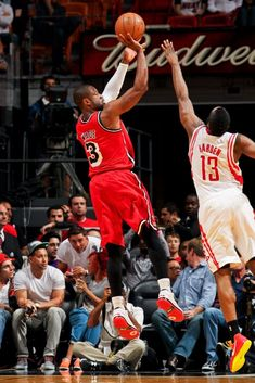 FEBRUARY 6: Dwyane Wade #3 of the Miami Heat shoots against James Harden #13