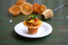 This is Nyonya Kuih Pie Tee or also known as Top Hats. It's an appetizer made with a savory, crispy thin fried shell, filled with stir-fry yam bean (jicama) and carrot.