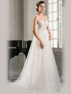 """""""Otylia"""" A-line wedding dress has delicate detailed lace over entire bodice and falls under layers of skirt. Soft tulle layer falls over patterned lace. Sheer illusion button up back with lace. Soft Layers, Illusion Neckline, Tulle Lace, Bridesmaid Dresses, Wedding Dresses, Fit, Illusions, Button Up, Off The Shoulder"""