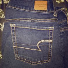 American eagle double buttoned jeans These jeans are so comfortable..the perfect jeans to wear for a night out for fun or whenever you'd like.. These jeans have sat in my closet for a while they are to big for me and they are in great condition gently used I've worn them a couple of times! Let me know if you would like to negotiate I'd be happy to American Eagle Outfitters Jeans Flare & Wide Leg