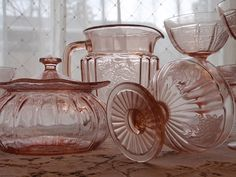 Depression Glass. I have many pieces of this glass inherited from my great grandmother and my grandmother. Just love it!!