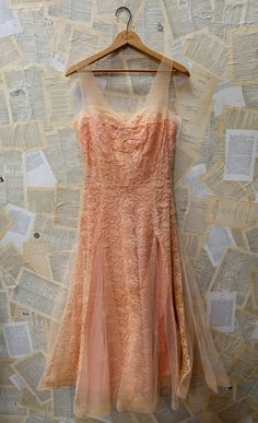 This beauty is in excellent vintage condition! The silhouette on this piece is so beautiful! The top layer is made of gorgeous blush/nude lace