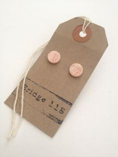 Ceramic stud earrings with pale pink glaze by Bridge118Ceramics