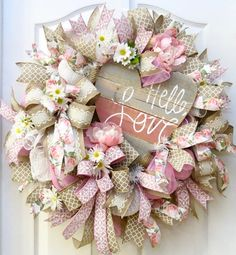 Valentine Wreath, Heart Wreath, Valentines Day Wreath, Deco Mesh Valentine Wreath, Valentine Decor, Love Wreath, Valentine Gift, florals Hello, Love! Imagine how warm and lovely your front door or place of business will look with this Valentines Day wreath. Soft, romantic, and feminine with a touch of rustic with the heart centerpiece. The base is handcrafted with plush ribbon loops made from jute mesh, pink mesh and white snowball mesh. Several large bows and ribbon streamers adorn…